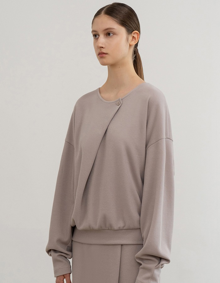 RE RHEE) RELAXED DIAGONAL PANEL SWEATSHIRT TOP BE